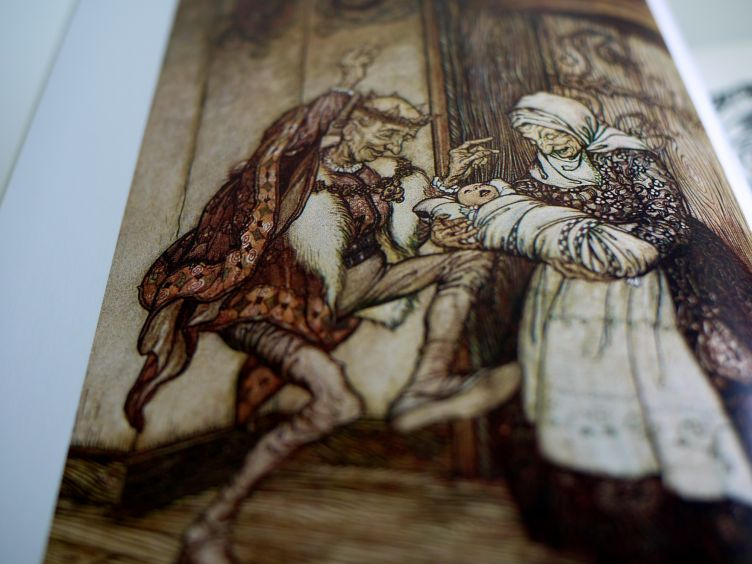 The Fairy Tales of the Brothers Grimm close-up of the frontispiece, illustration on glossy paper.