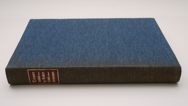 Treasure Island by Robert Louis Stevenson (1941) the binding, showing just how much the spine's faded over time.