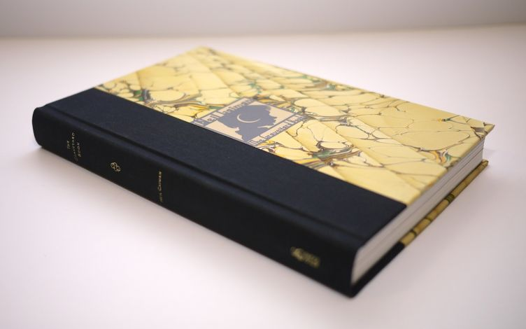 The Graveyard Book by Neil Gaiman with illustrations by Dave Mckean (2008) Iris cloth binding with Ann Muir marbled paper.