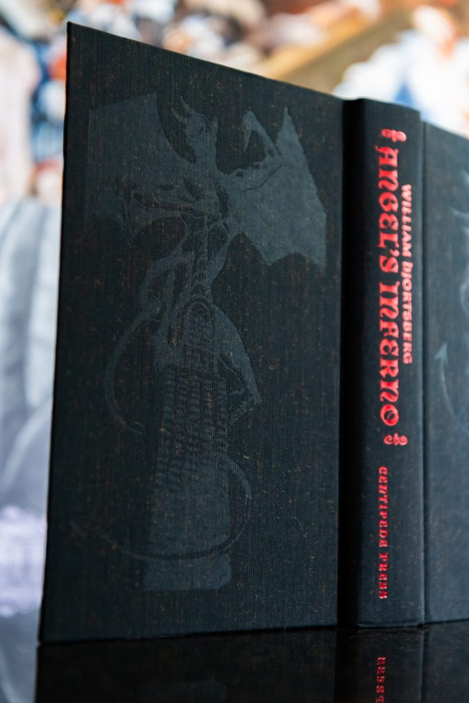 Board decorations and blind stamps on Angel's Inferno from Centipede Press