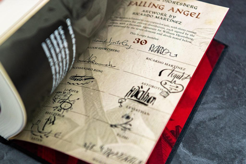 Signature page of Falling Angel showing signatures by William Hjortsberg and seven demons and devils