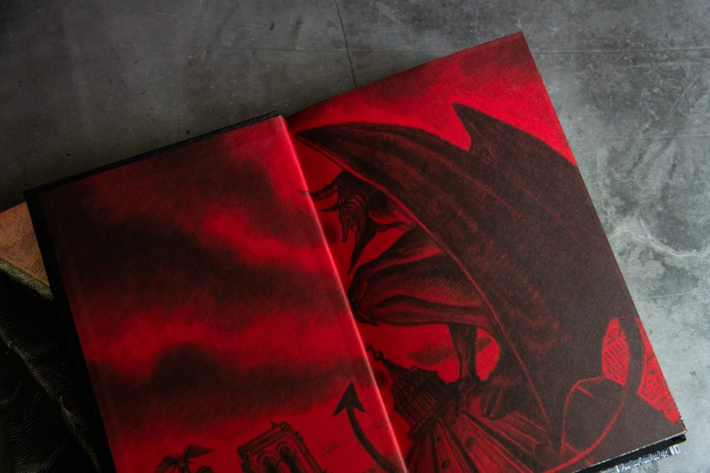 Red and black endpapers from Angel's Inferno from Centipede Press