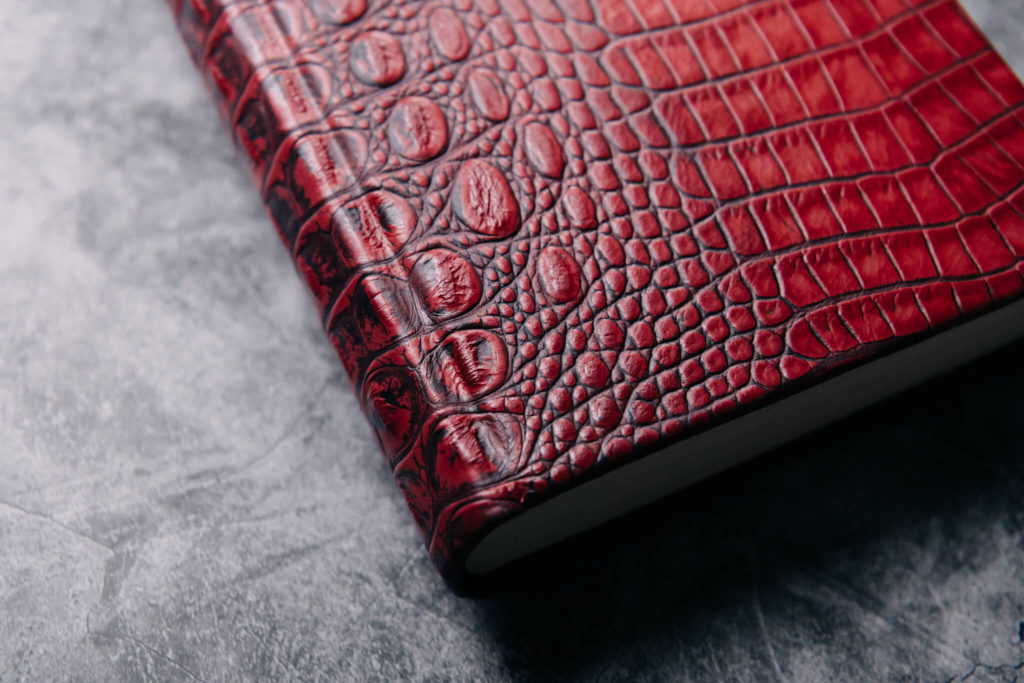 Suntup Press Red Dragon leather edition binding close up showing scales