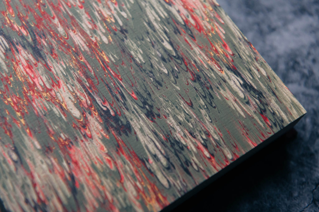 Detailed shot of the marbled endpapers of the numbered edition of Red Dragon by Suntup Press