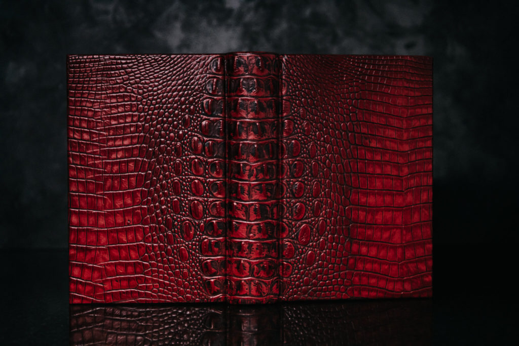 Suntup Press Red Dragon leather binding in darker light